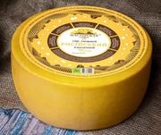 Российский,  твёрдый сыр в парафине,  50% жирности